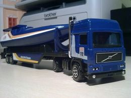 Majoteams city volvo f12 globetrotter powerboat transporter model trucks 6ac17519 73ee 48be ae34 7c54ccff2356 medium