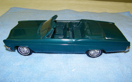 Amt 1966 chevrolet impala super sport convertible promo model car  model cars c89c3f45 ac26 4bd4 80b4 cf0b24779c01 medium