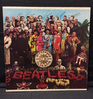 The beatles   sgt. peppers lonely hearts club band cds and lps 7105cc25 a4fc 4e85 8441 aaae844722c0 medium