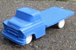 Processed plastic chevrolet flatbed truck model trucks 8b38f2e7 c5c3 4f6c 8363 c22815b313ef medium