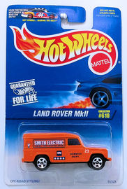 Land Rover MkII | Model Cars | HW 1997 - Collector # 610 - Land Rover MkII - Orange - USA Blue & White Card