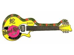 Snake guitar   yellow pins and badges 78312e13 35a9 43b7 8859 72f8f8b5b2ee medium
