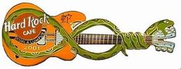 Snake guitar   orange guitar with green snake pins and badges 03cc0e0a 9e6e 46b5 bc9e 629119203ae8 medium