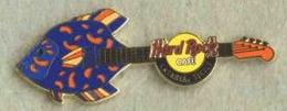 Catania   2004   fish guitar %25232 pins and badges b9db58b2 76b6 486d b856 eac30fb4be61 medium