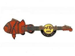 Fish guitar   orange and black fish pins and badges a8fa4e25 b772 4f29 8f7b daf4ffc1bdcb medium