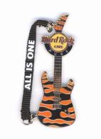 Mantra Strap Guitar.   Pins & Badges
