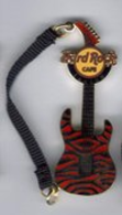 Guitar whit strap red pins and badges 6f6b5dd6 7ae4 47c0 9d4b 36059fd28cc6 medium