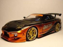 Jada toys import racers mazda rx7 model cars 3bdabd5f 0361 4974 ad31 d5ecc8a2127b medium