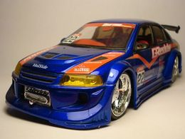 Jada toys import racers mitsubishi lancer evolution vi model cars 5980703a 22a8 4744 b0be c1de75528b66 medium