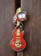 Vertical red guitar with bus %25232 pins and badges ddeca596 cc01 4107 aed6 37fad5d7b960 medium