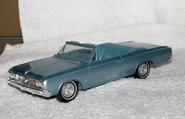 1964 oldsmobile cutlass convertible promo model car  model cars c3f3e9c8 5297 46ab 9dfe fe00d4aa45e3 medium