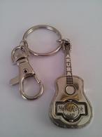 Silver spinning guitar keychains 0f0e7d54 13e3 4cd1 831d 7b35065b0741 medium