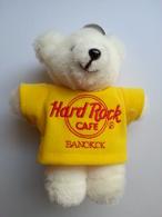 White plush bear with yellow shirt keychains cb3cec9c 38e7 4d6c 89e7 9edd762e34d9 medium