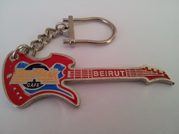 Red guitar with silver chain keychains 92a8555a 64a1 411b 9909 b43cd48ed8d4 medium