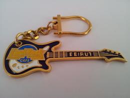 Blue guitar with gold chain keychains 29fe4e97 0d75 48b9 9741 259fe22a56f7 medium