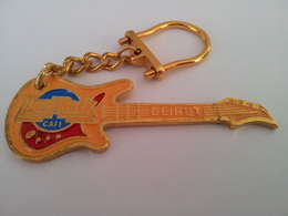 Yellow guitar with gold chain keychains 3bf22cf9 8d04 46f7 81e2 c90643ee2698 medium