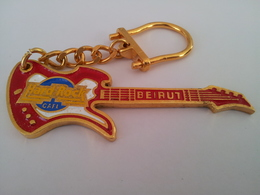 Red guitar with gold chain keychains 143738c8 cfb2 42a2 a2ce 36ca0afe77c4 medium
