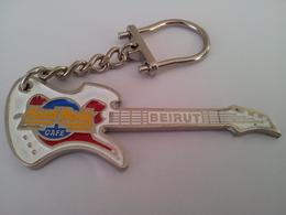 White guitar with silver chain keychains 1adf05b5 b90c 418d 8edd 31655576bfe7 medium