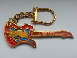 Red guitar with gold chain keychains 00c3a835 51d0 4849 9d4b ca8808f213e2 medium