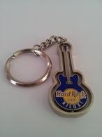Blue spinning guitar keychains f8a2175a 46eb 499b 90bb f22db4e3d742 medium
