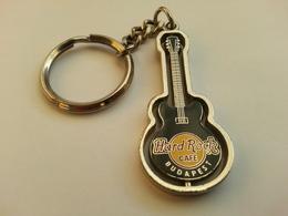 Black spinning guitar keychains e9c9a320 6d09 44d3 9ece dc930b88d681 medium