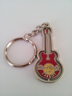 Red spinning guitar keychains 468fbf1b d6e0 4579 95a3 b1fb43913357 medium