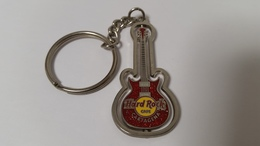 Red spinning guitar keychains b2c97b62 f721 4843 9319 aa723a028d10 medium