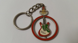 Red circle with spinning guitar 2004 keychains d4e59223 9857 4477 b92b 704875a9f4e4 medium