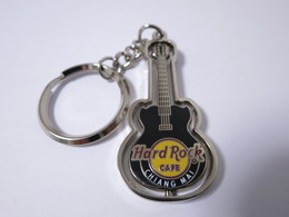 Black spinning guitar keychains 895b85be b917 46d7 830f 6f87cd842fda medium
