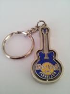 Blue spinning guitar keychains bca348f2 7739 46fa 8125 c4625c75110d medium