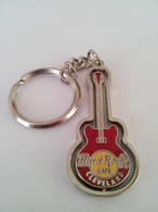 Red spinning guitar keychains a8694a4b 28f1 45a2 ab31 f334dca6436b medium