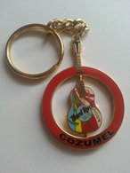 Red circle with spinning guitar 2004 keychains d5322fb7 632a 4786 8878 2b9ffe43e964 medium