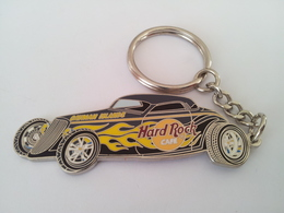 Grey and yellow car keychains 71ee8d15 a4c9 4c7d ae1b 838a4b1ce7d2 medium