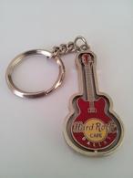 Red spinning guitar keychains 701892b2 437b 4441 a725 250aae445059 medium