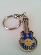 Blue spinning guitar keychains 9a77e7de 8d22 49d3 a709 bf31314f02ef medium