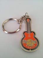 Orange spinning guitar keychains 5c50c07d c14c 4d2a 86df 801735b3ab8e medium