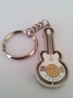 White spinning guitar keychains 444cca97 26a3 467a a429 5232d53dbc8a medium