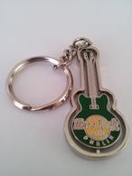 Green spinning guitar keychains 69196690 b741 4ac3 aabc c87c499b2836 medium