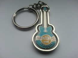Turquoise spinning guitar keychains 7e3fc683 a95d 4ce8 977b 539c39d1c69d medium