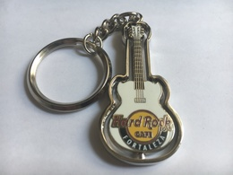White spinning guitar keychains e51d5139 68e5 4b71 915a 61cb385dc42a medium