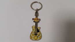 Yellow and white guitar keychains 50f3e110 9d2a 4bf2 8baa 645b5dc8f9ed medium