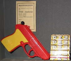 Pez 20gun 20red 20with 20yellow 20grip medium