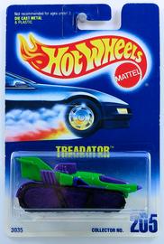 Treadator       Model Cars   HW 1996 - Collector # 205 - Treadator - Dark Green - Purple Hot Wheels Logo Top of Right Front Fender - USA Blue & White Card