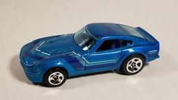 Datsun 240z model cars 91df8b67 c642 43d9 980a 7c12fd59e710 medium