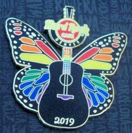 Butterfly pride guitarblack guitar with pride color butterfly wings pins and badges 6c9396e9 148f 4c47 b178 413acfa6d219 medium
