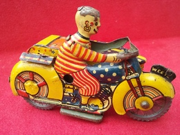 Mettoy clown motorcycle and sidecar tinplate and pressed steel toys 45665576 02e6 4024 a195 36fe0fc1d04e medium